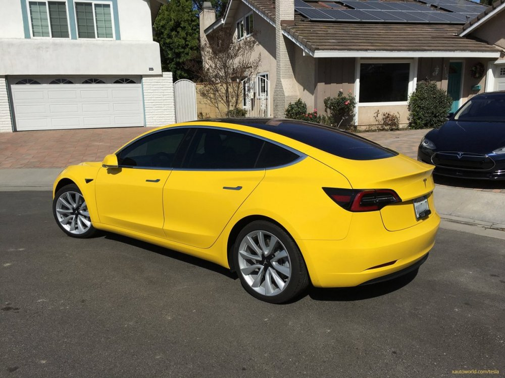 yellow-tesla-model-3_rear-side-view.jpg